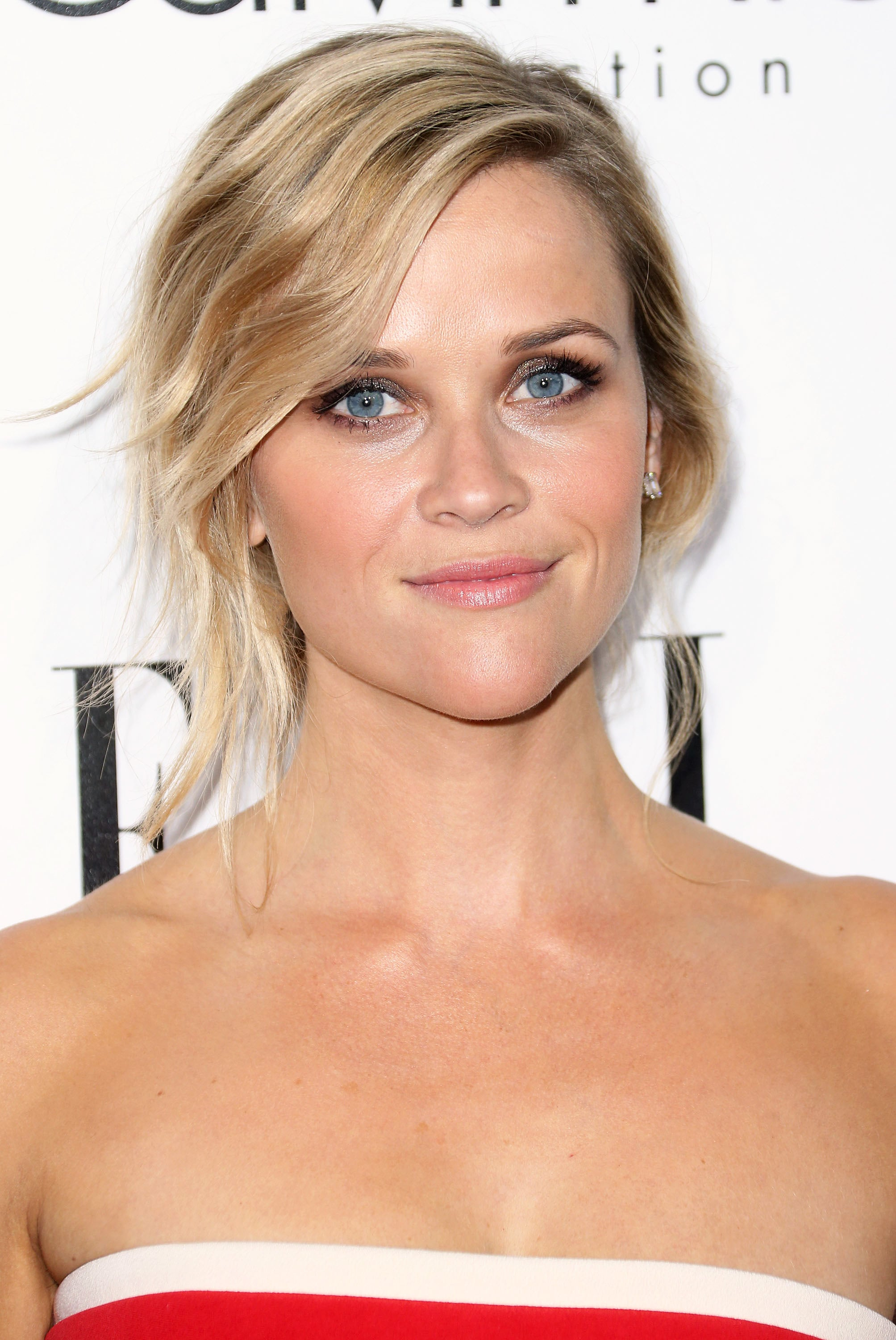 You can't go wrong with a classic, and Reese Witherspoon's tousled chignon was definitely a winning moment for the actress. She kept her makeup look simple with just a touch of metallic shadow and pink lipstick, Lancome's Rouge in Love in Jolis Matins ($26).