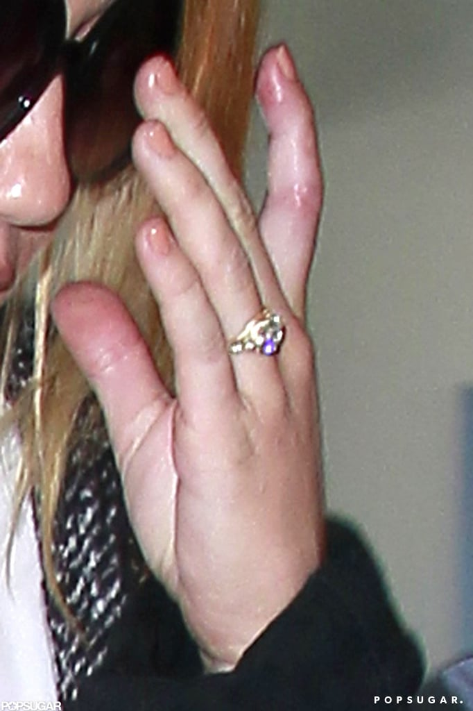 Miley Cyrus's engagement ring was on display as she traveled through LAX.