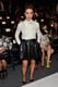 Alyssa Milano tucked a prim ivory bow blouse into an edgier black leather skirt at the Marissa Webb show during New York Fashion Week.