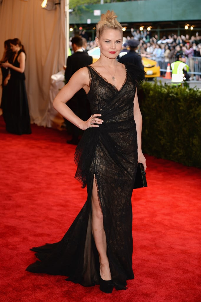 Jennifer Morrison showed off an asymmetrical, reptilian black lace Donna Karan gown with a leg-flaunting slit.