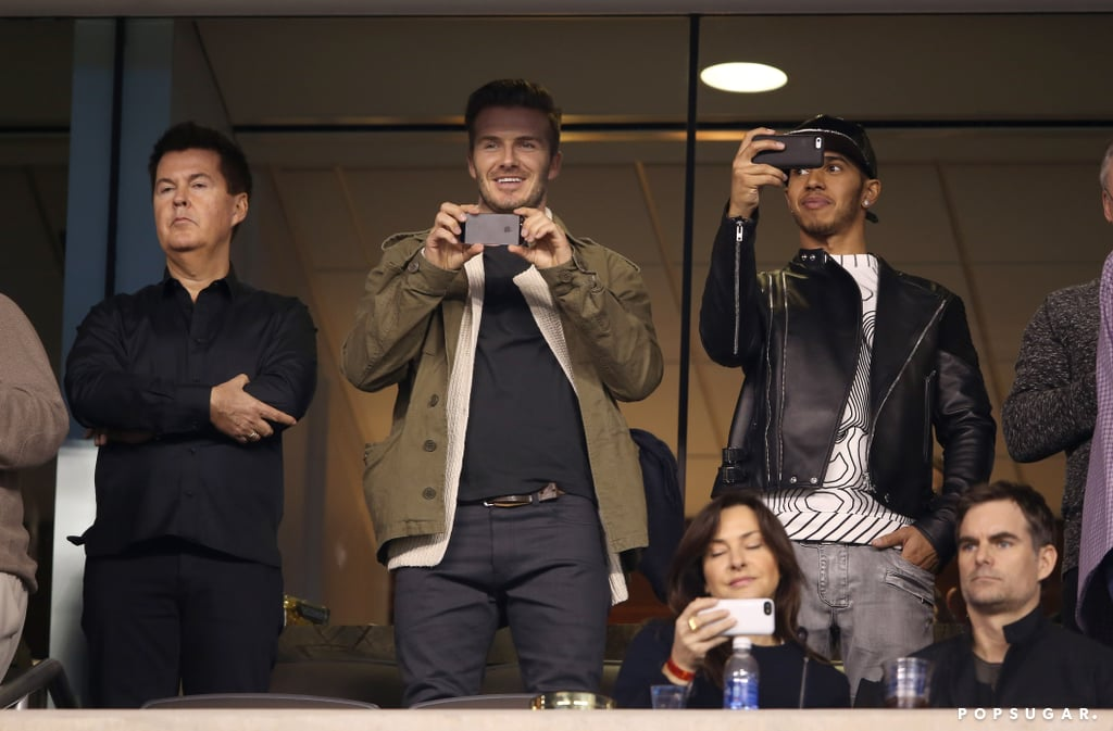 David Beckham and Lewis Hamilton captured the game on their phones.