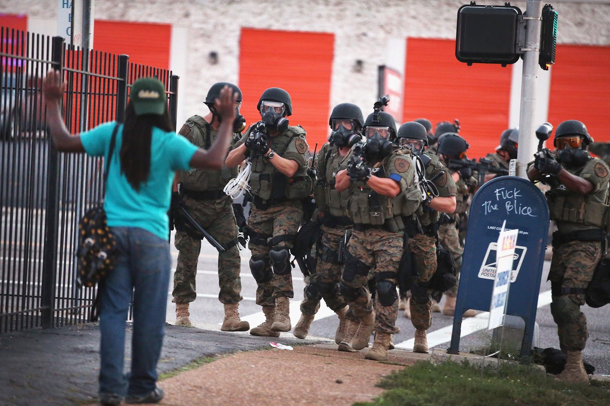 A woman encountered armed police on a Ferguson, MO, street.