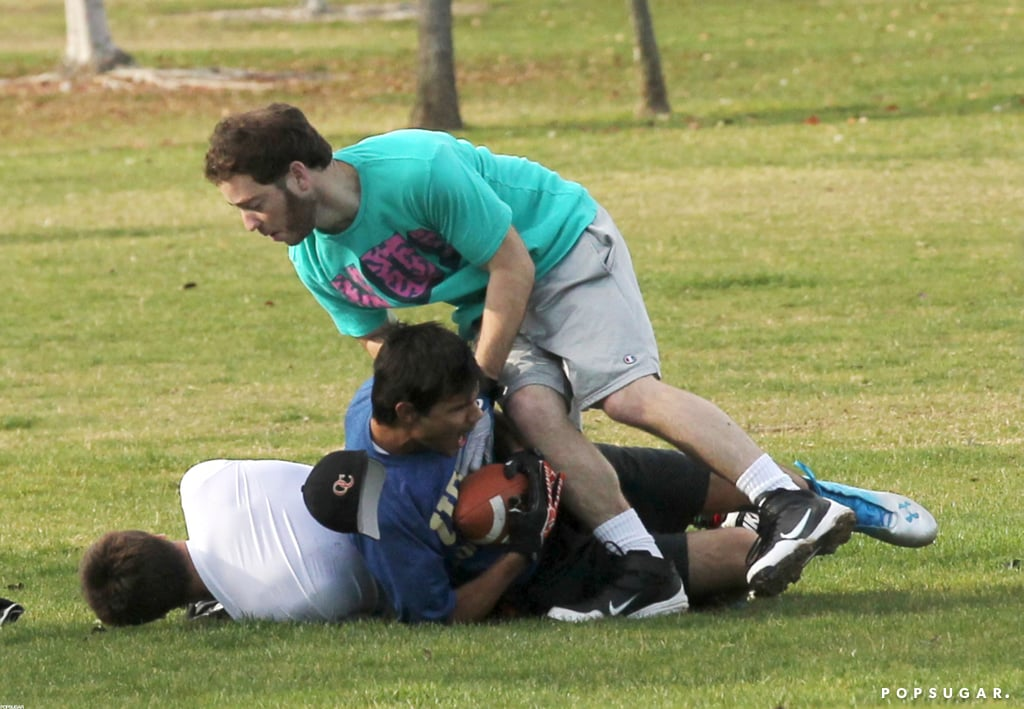 Taylor Lautner got tackled by friends during a game.