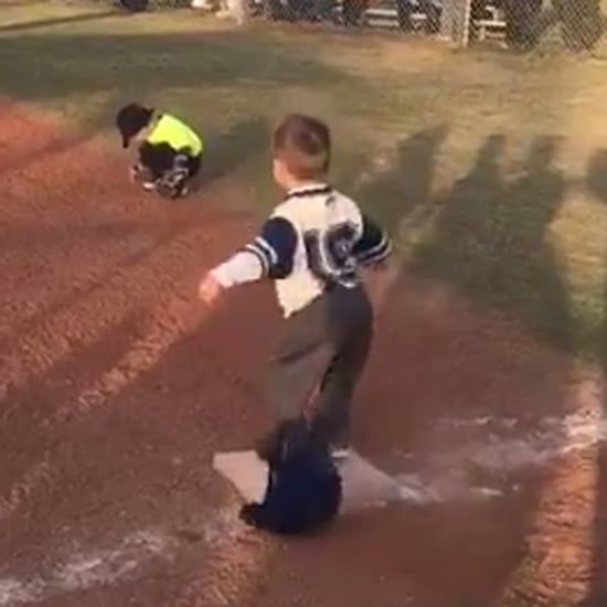 Little Boy Doing Victory Dance at First Base