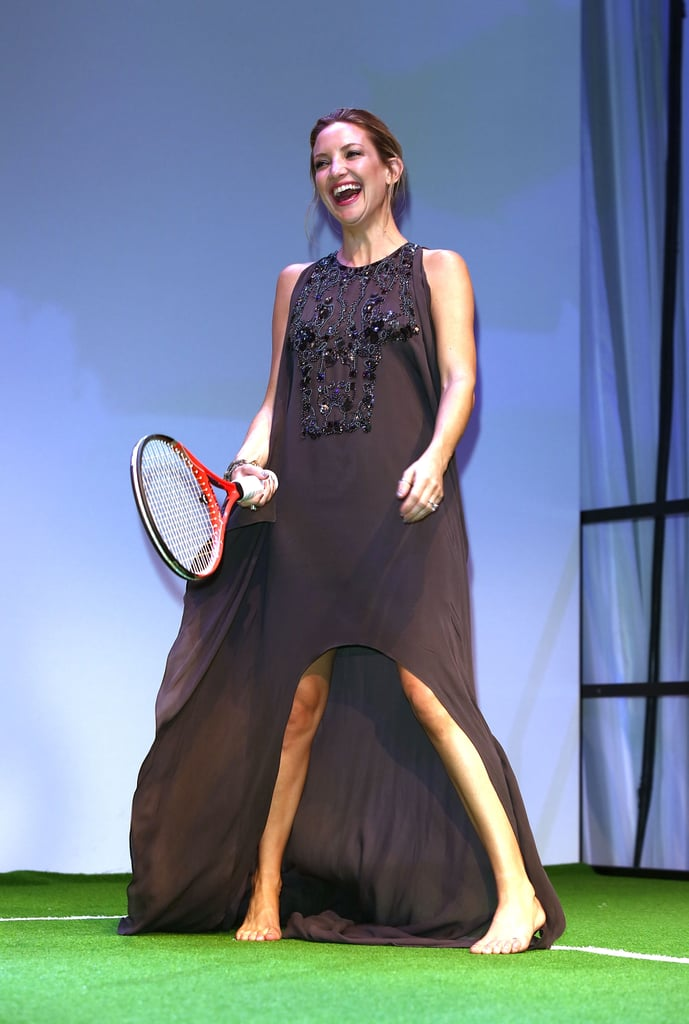 Barefoot tennis in a designer gown? Why not, says Kate Hudson. She was at the Novak Djokovic Foundation Gala Dinner on July 8 when she had a swing of the racquet.