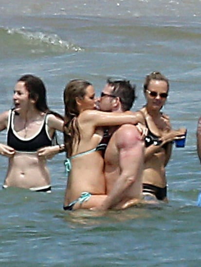 Blake Lively Shows Off Growing Baby Bump While Kissing Ryan Reynolds During Holiday Getaway
