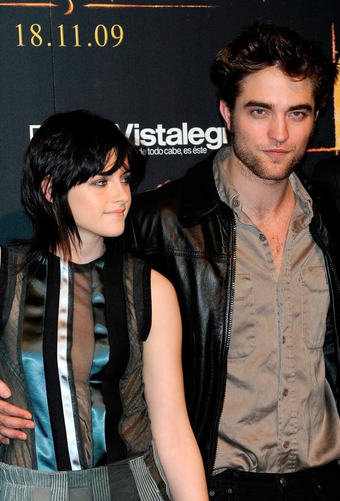 Robert Pattinson had his hand around Kristen Stewart's waist during a fan event in Spain in November 2009.