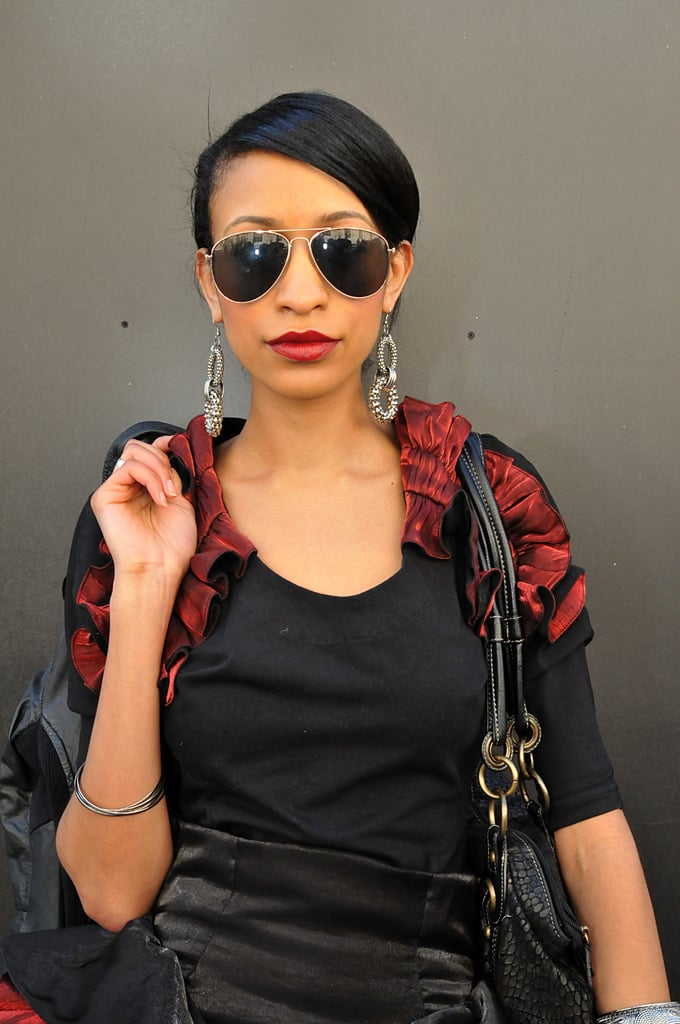 With her candy-apple lips and black, sideswept hair, this stylish lady made being a medical doctor look even hotter.