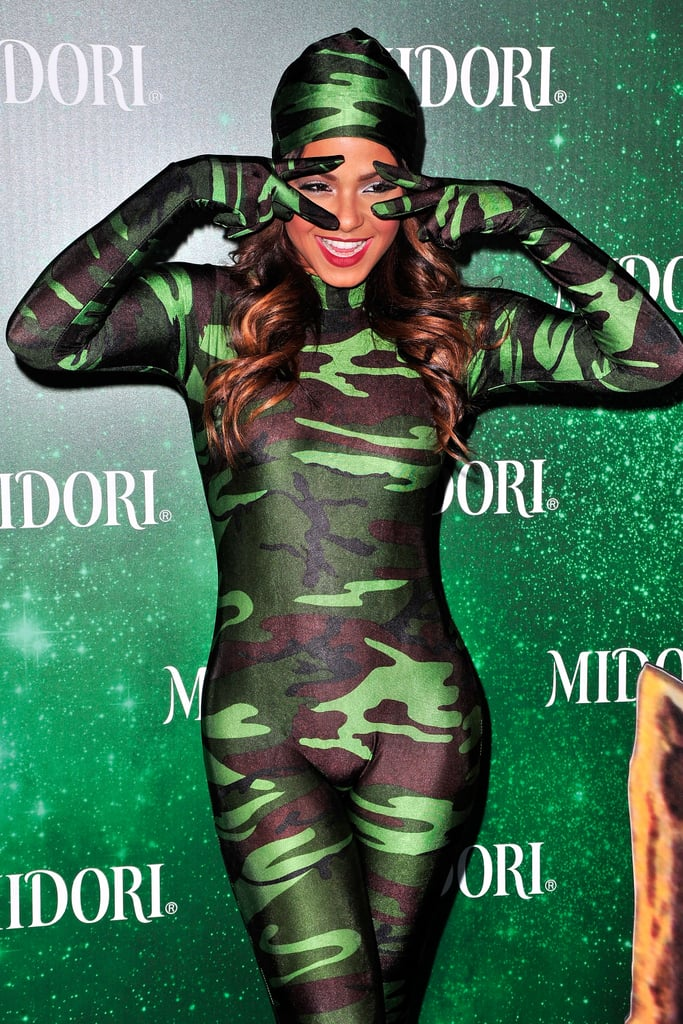 Christina Milian stood out at the Midori Green Halloween party in LA, despite wearing a camouflage ensemble.