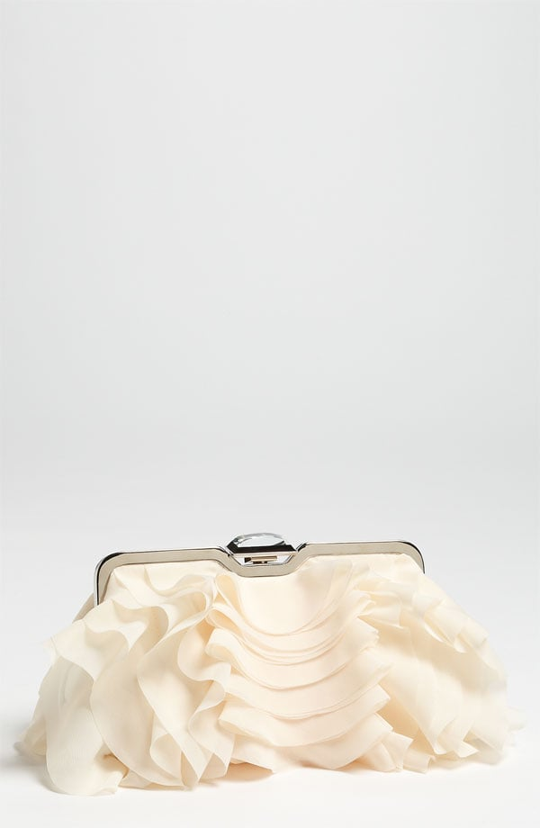 Such a luxe-looking find for under $100.  Glint Glint Ruffle Front Clutch ($88)