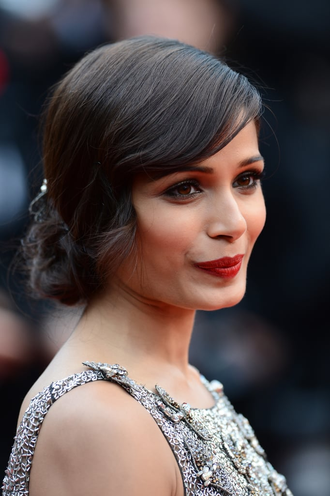 Usually, Freida sticks to a neutral palette, but she turned on her sultry side with a cherry red lipstick and smoky eye on the Jeune & Jolie red carpet at the Cannes Film Festival.