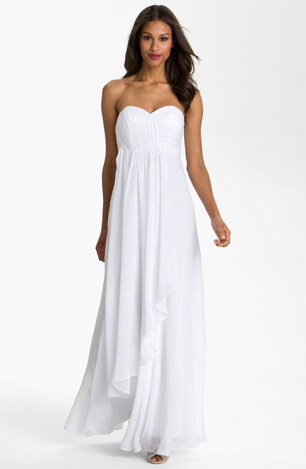 The layered chiffon gives that breezy at-the-beach vibe you just might be looking for.  Dalia MacPhee Strapless Ruffle Front Chiffon Gown ($328)