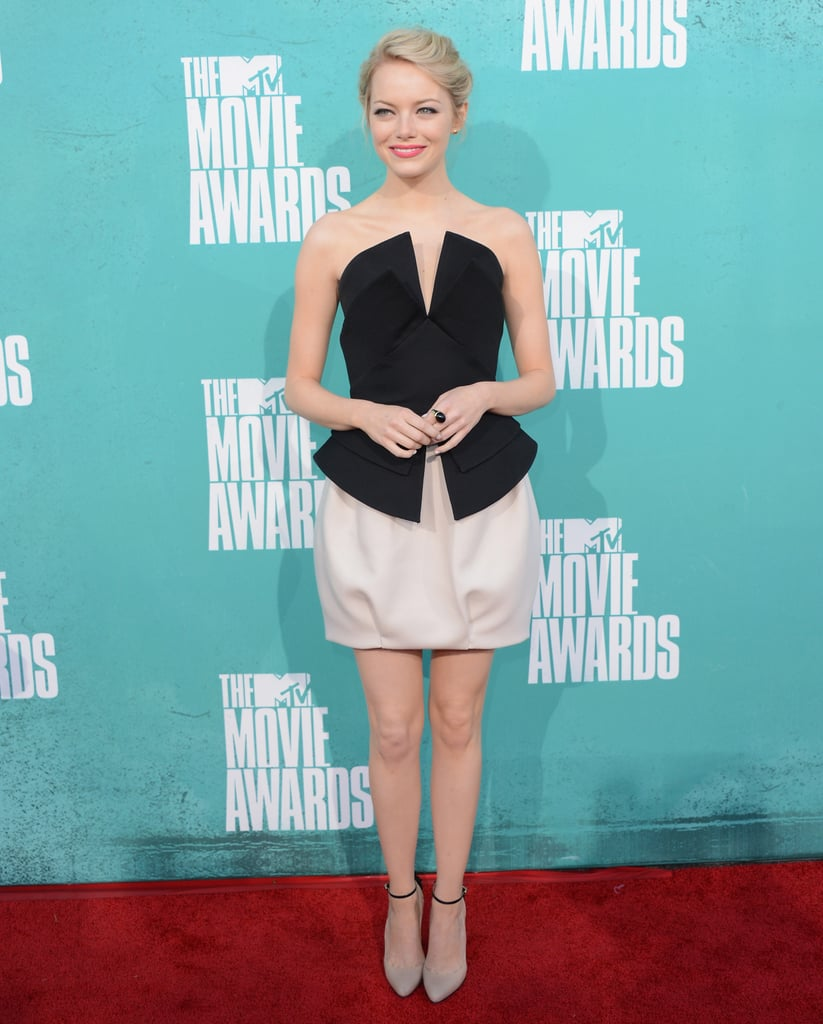 Emma Stone went short and flirty in a black and white Martin Grant mini at the MTV Movie Awards in September.