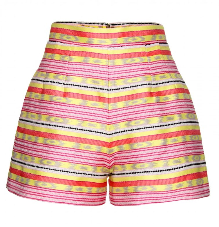 We'd pare down the bold hue with our favorite tank, then add in neon sandals to play off the fun pattern.  Carven High-Waisted Jacquard Shorts ($525)