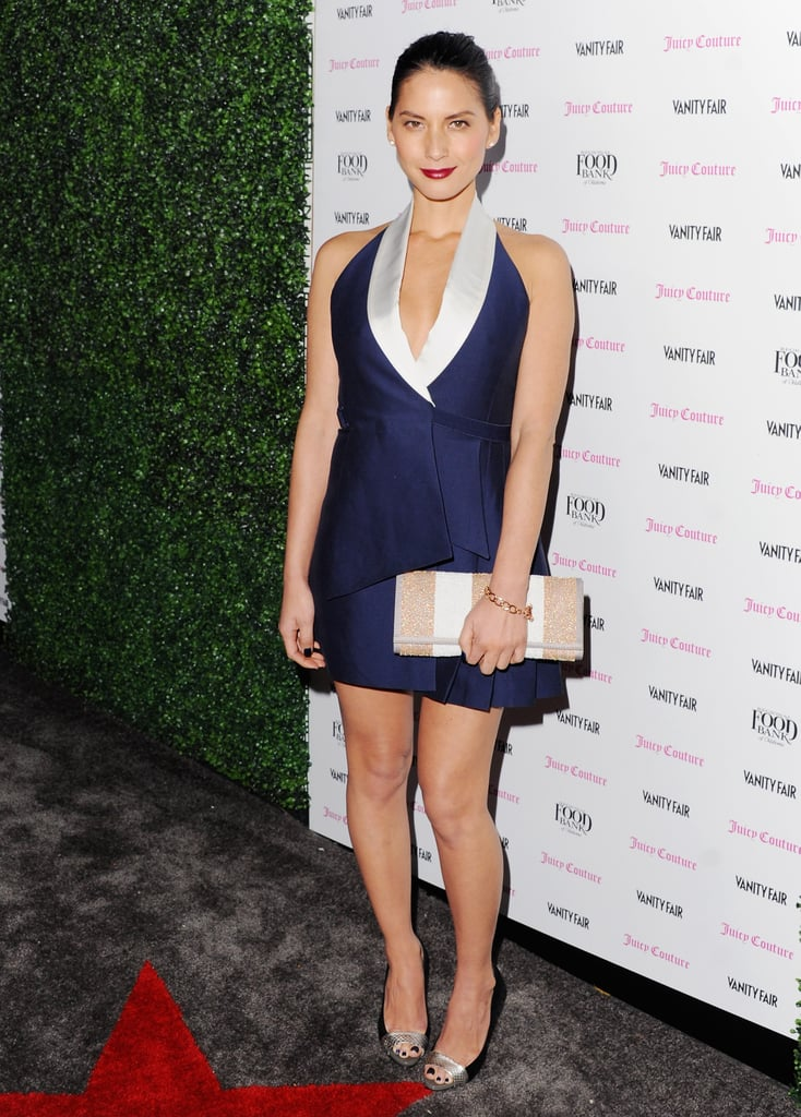 Olivia Munn, who also hosted the party, went with a cocktail-perfect Bird dress — we're loving the nod to sleek tuxedo dressing. She finished off her minidress look with Juicy Couture jewelry, a Juicy Couture striped clutch, and Jean-Michel Cazabat peep-toe pumps.