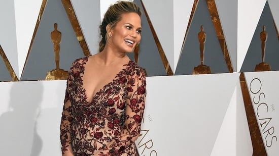 Chrissy Teigen Posts Snapchat Photo Breastfeeding Daughter Luna And People Are Losing Their Sh*t, Because Of Course They Are