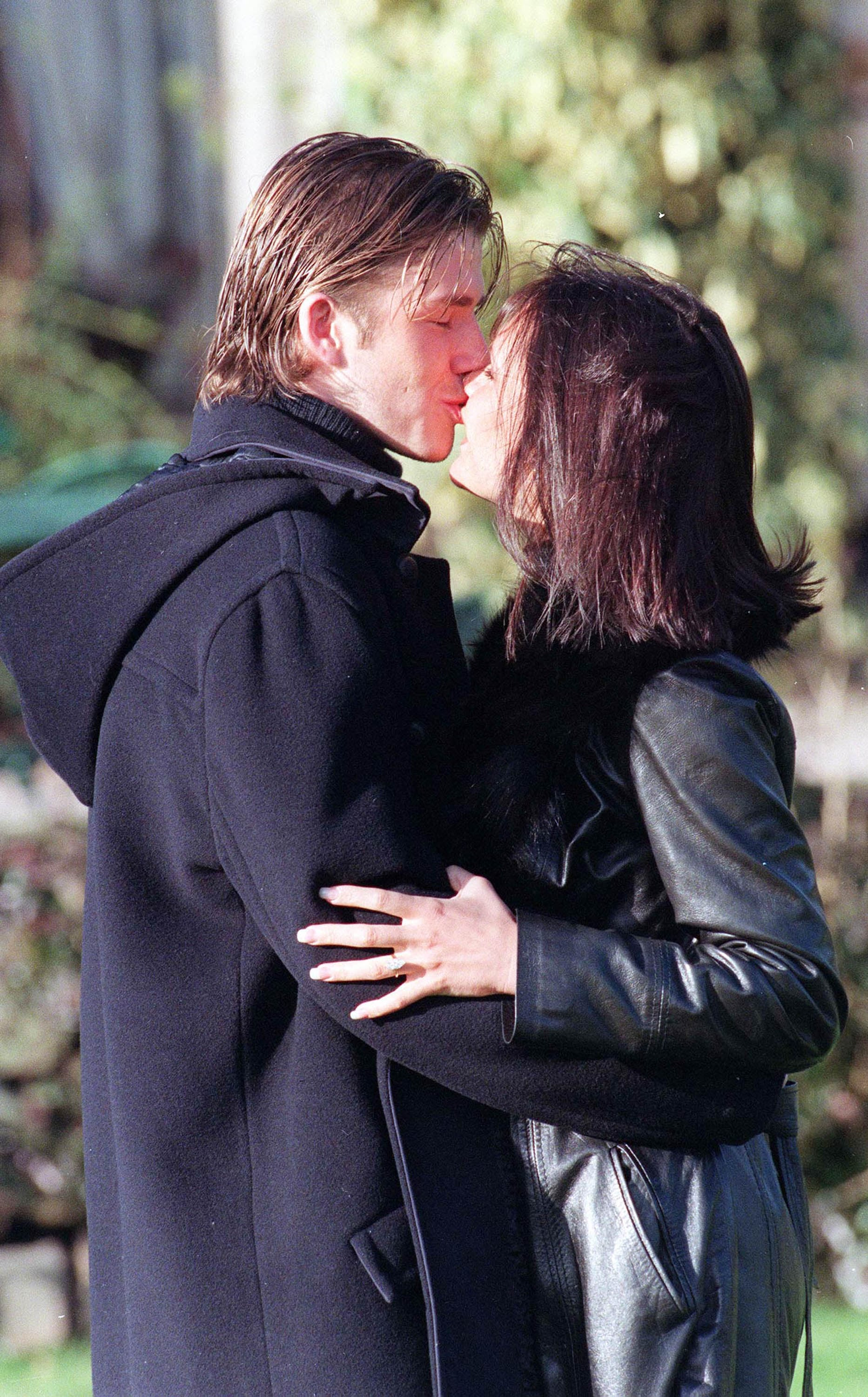 David and Victoria Beckham embraced outside of their Chester, UK, hotel after announcing their engagement in January 1998.