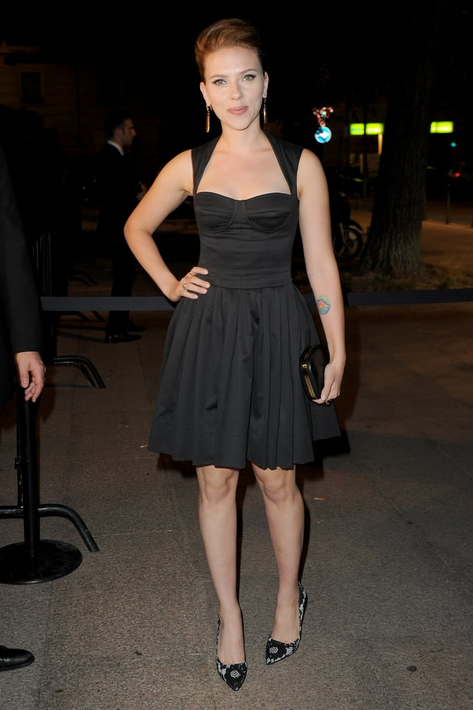 Scarlett wore printed pumps with her black dress.
