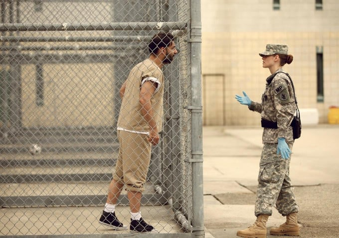 Cole interacts with a Guantanamo Bay prisoner. Source: Gotham Group