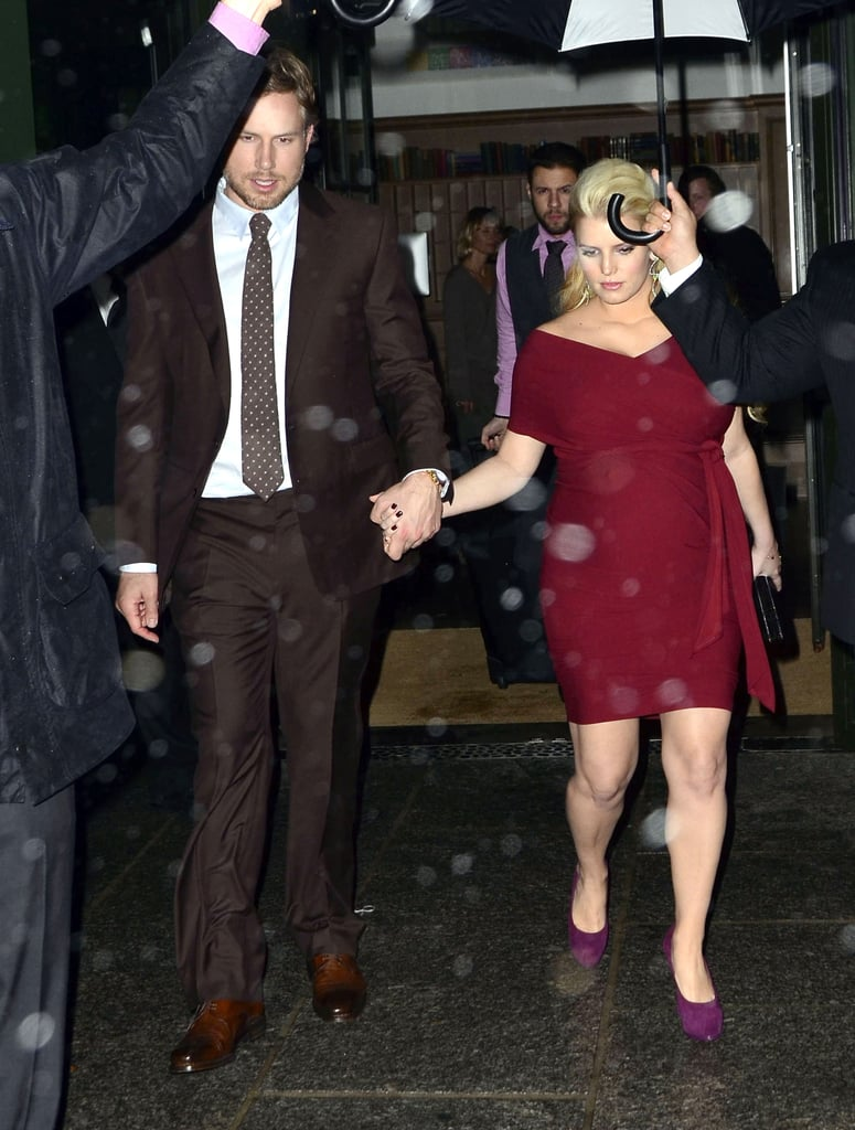 Jessica Simpson and Eric Johnson ducked out of the rain in NYC.