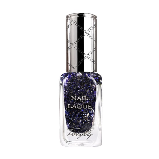 Reimagine a jewel-toned manicure with By Terry Nail Laque Glitter Glow Top Coat ($30). The scintillating sapphire glitter enhances a basic navy polish.