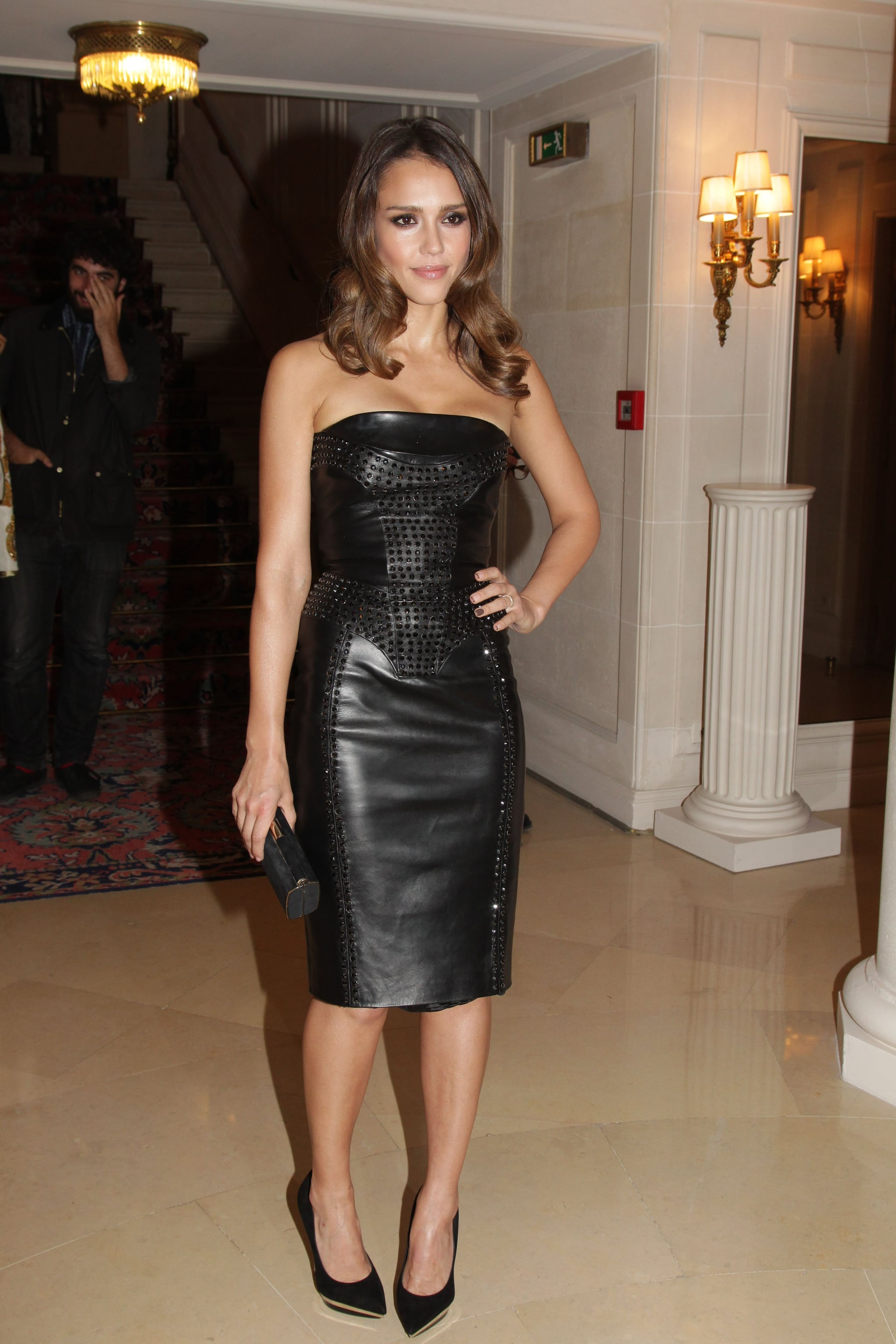 Jessica Alba struck at pose as she arrived at the Versace show for Paris Fashion Week.