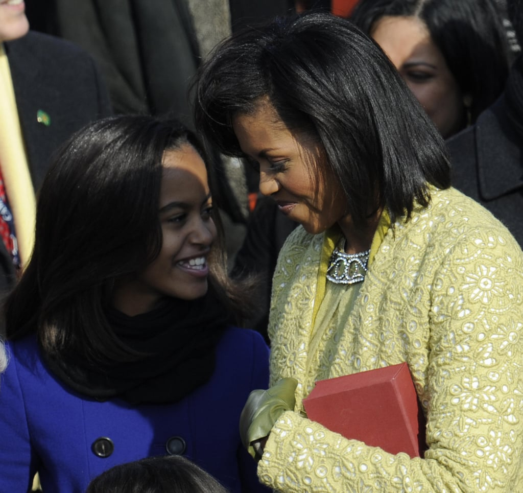 Michelle and Malia shared a moment at Barack's 2009 inauguration.