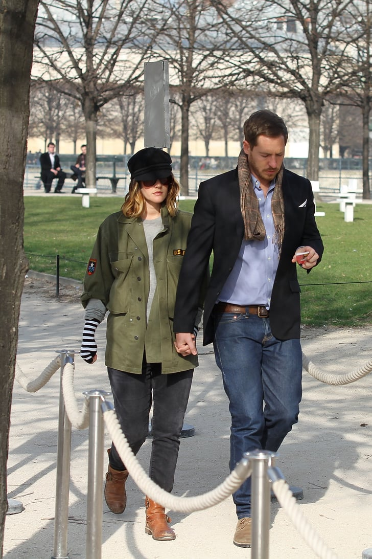 Drew Barrymore and fiancé Will Kopelman walk through the Tuileries in Paris.