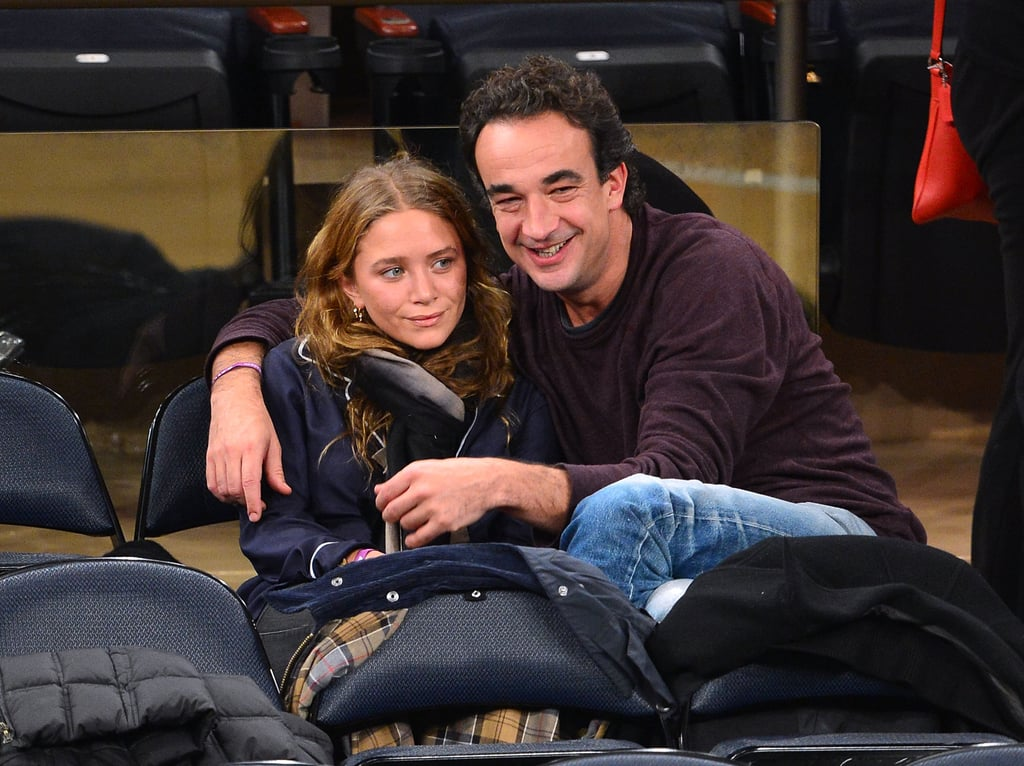 Olivier Sarkozy wrapped his arms around Mary-Kate Olsen at the New York Knicks game.