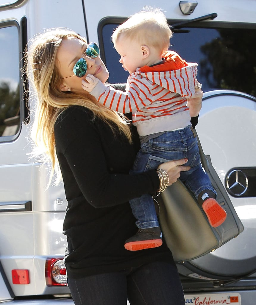 Hilary Duff carried Luca Comrie on her way into a friend's house.
