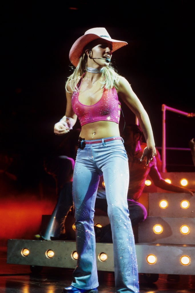 She rocked a cowgirl hat and midriff in June 2000.
