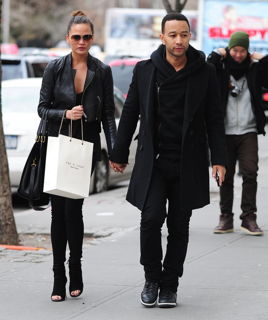 Chrissy Teigen shopped in NYC with boyfriend John Legend looking slick in all black, including a leather jacket and peep-toe booties.