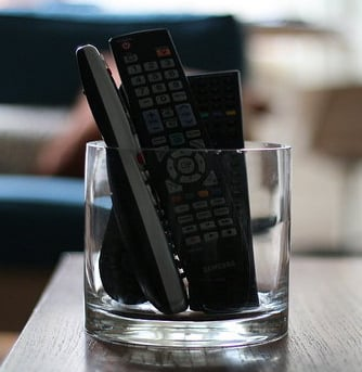 Geek Tip: Corral Remotes in a Clear Vase