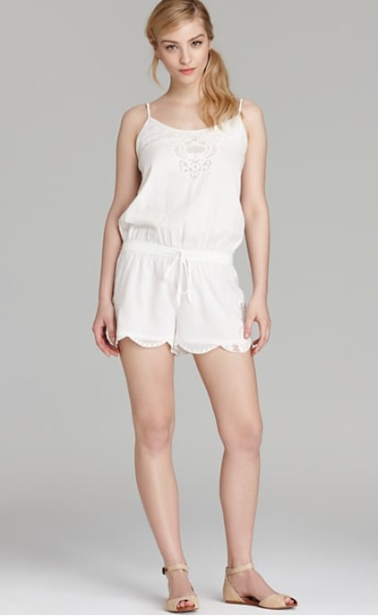 This Joie white embroidered romper ($248) is a great canvas for styling. Just add a denim jacket and tan sandals to really make it come to life.