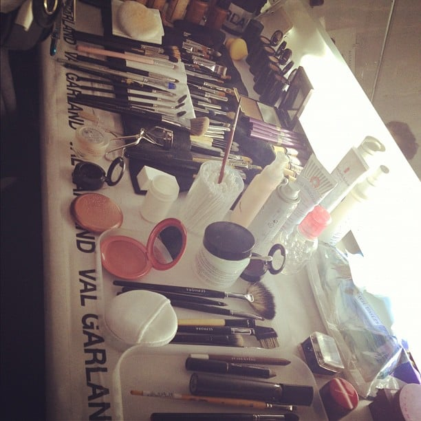 Sometimes the makeup stations backstage look like the Olympics of beauty.