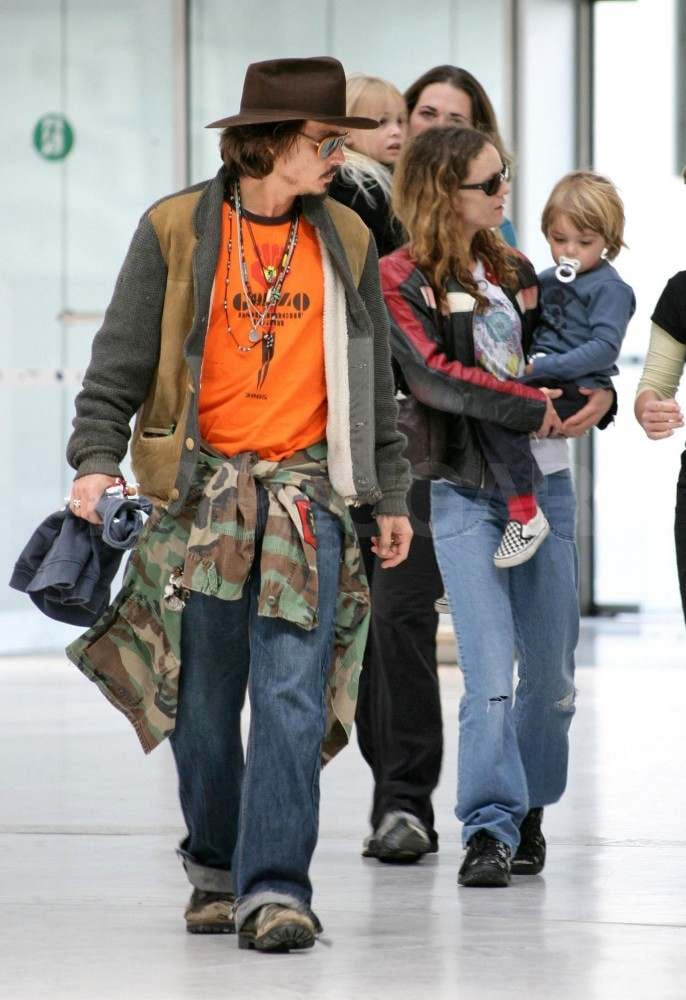 Johnny and Vanessa arrived at the airport in Nice with their kids, Lily and Jack, during a May 2006 trip.