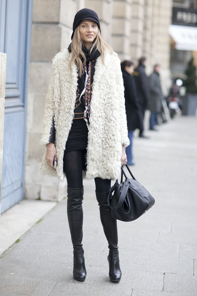 A furry coat played opposites against sexier over-the-knee boots.