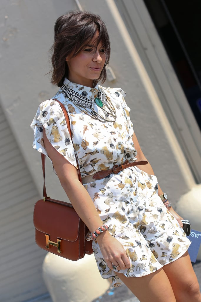 Miroslava Duma did the accessory balancing act just right with an understated Hèrmes purse and high-wattage statement necklace.