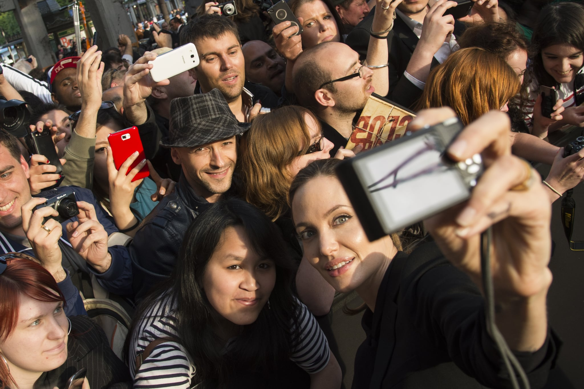 Angelina Jolie smiled for a photo while attending Brad Pitt's Paris premiere of World War Z in June 2013.