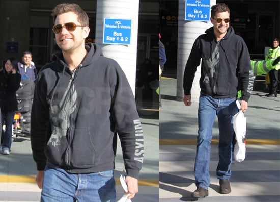 Photos of Joshua Jackson Arriving at the Vancouver Airport Wearing a Navy Sweatshirt and Jeans
