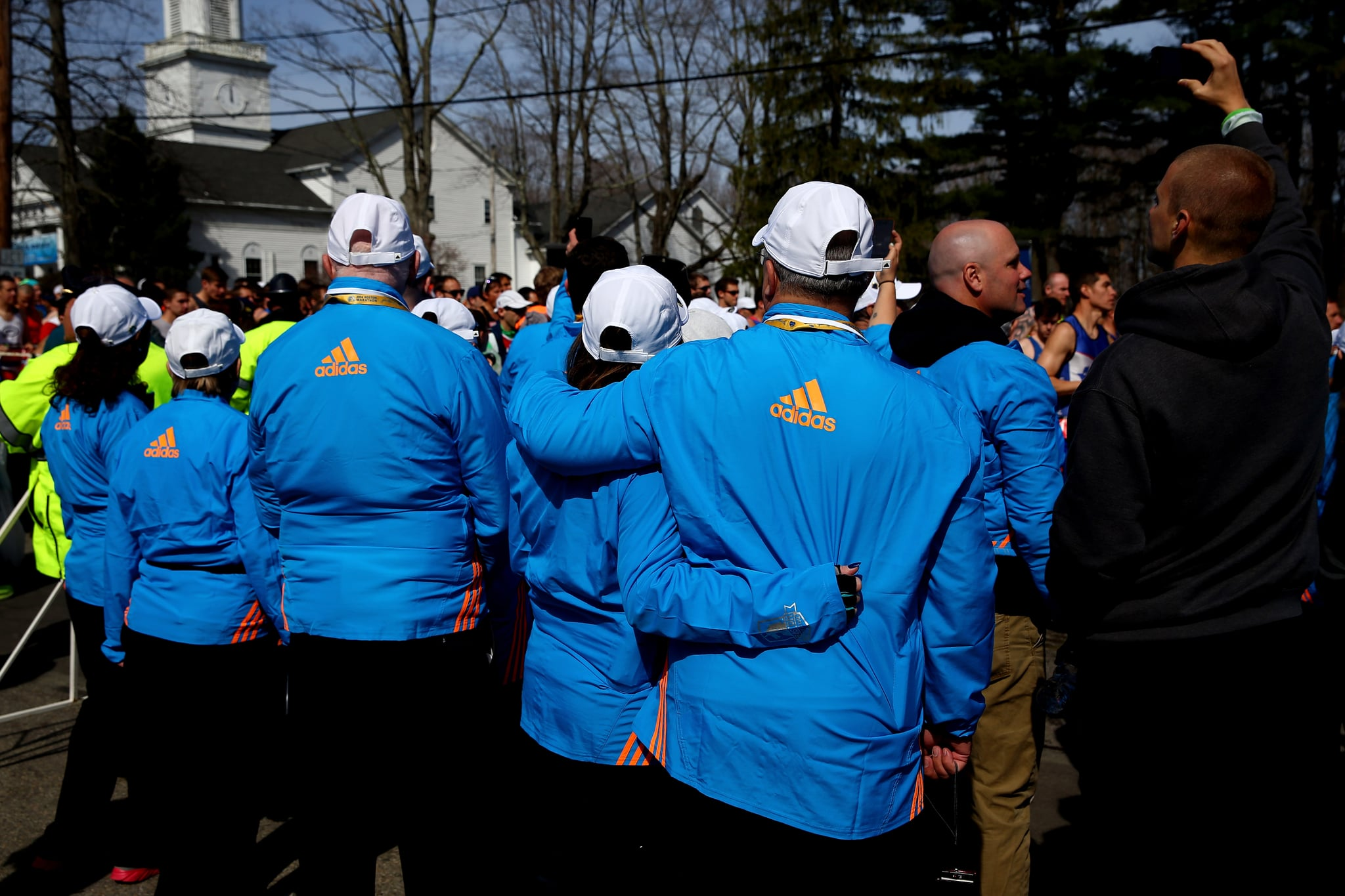 Volunteers had their arms around one another while they watched the race.