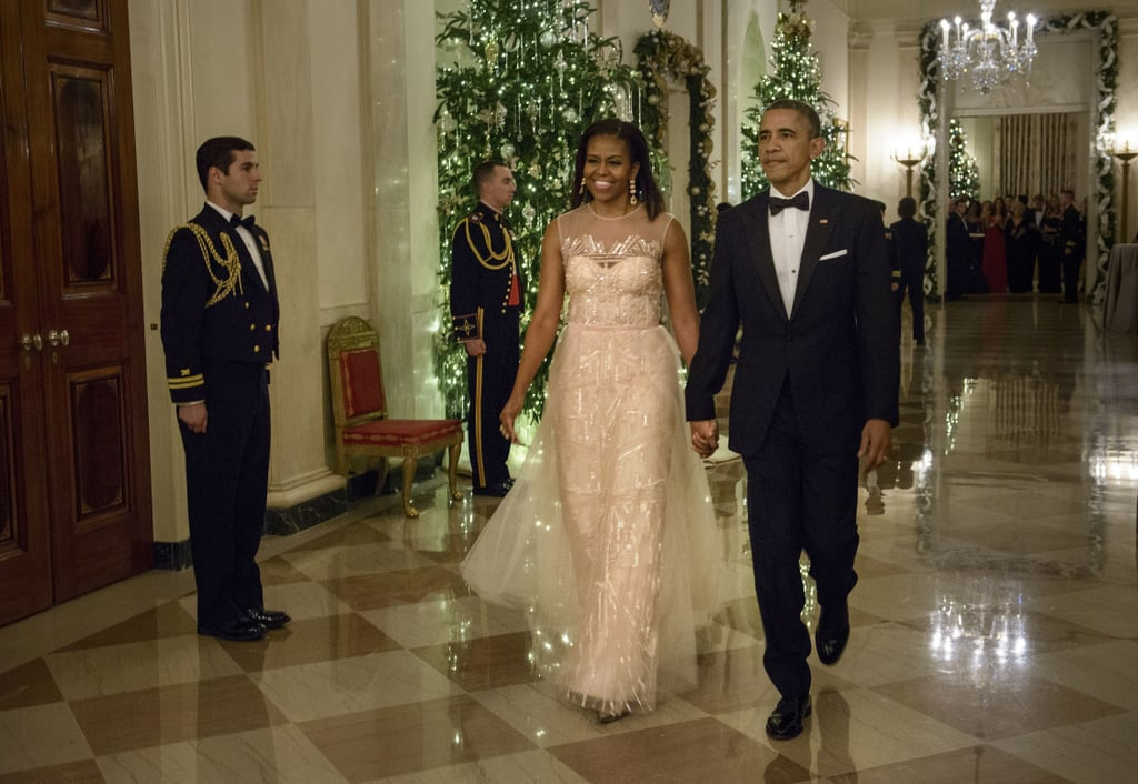 The first lady wore an embellished blush-pink Monique Lhuillier gown to the 37th annual Kennedy Center Honors on Sunday, which she chose to accessorize with matching drop earrings.