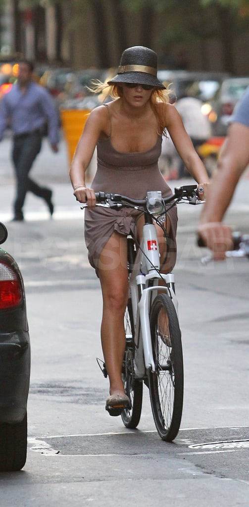Blake Lively rides bikes without a helmet.