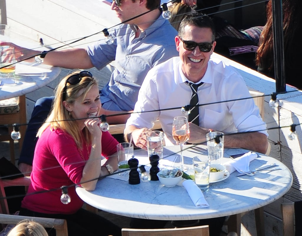 Reese Witherspoon stuck to water while Jim Toth drank wine during lunch at the SoHo House in NYC.