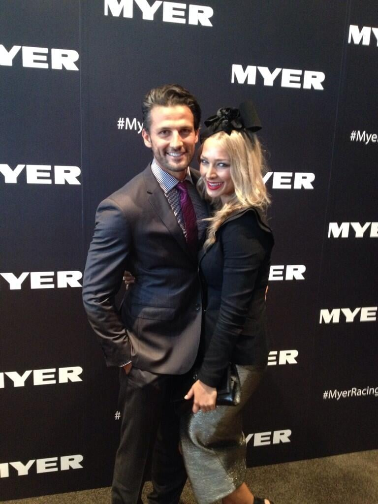 Cute couple Tim Robards and Anna Heinrich took a minute to pose for a happy snap at the races. Source: Twitter user MrTimRobards