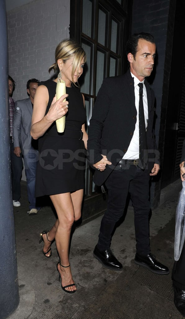 Jennifer held on tight to Justin's hand.