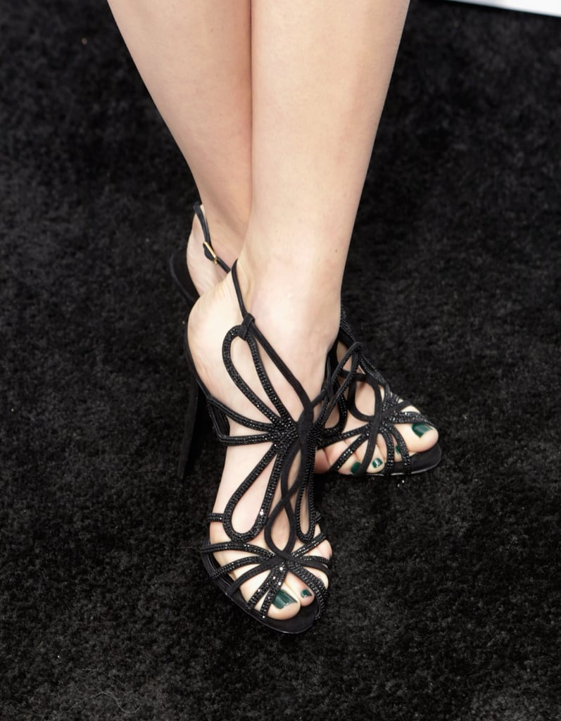 Emmy Rossum's crystal-embellished sandals lent subtle shine to her LBD at the Weinstein pre-Oscar party.