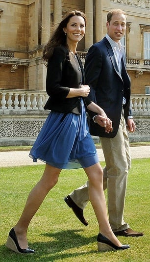 The cute couple took a stroll the day after their wedding in cool, albeit casual, outfits. Kate wore a blue Zara dress, a black blazer, and Greta wedges by LK Bennett.