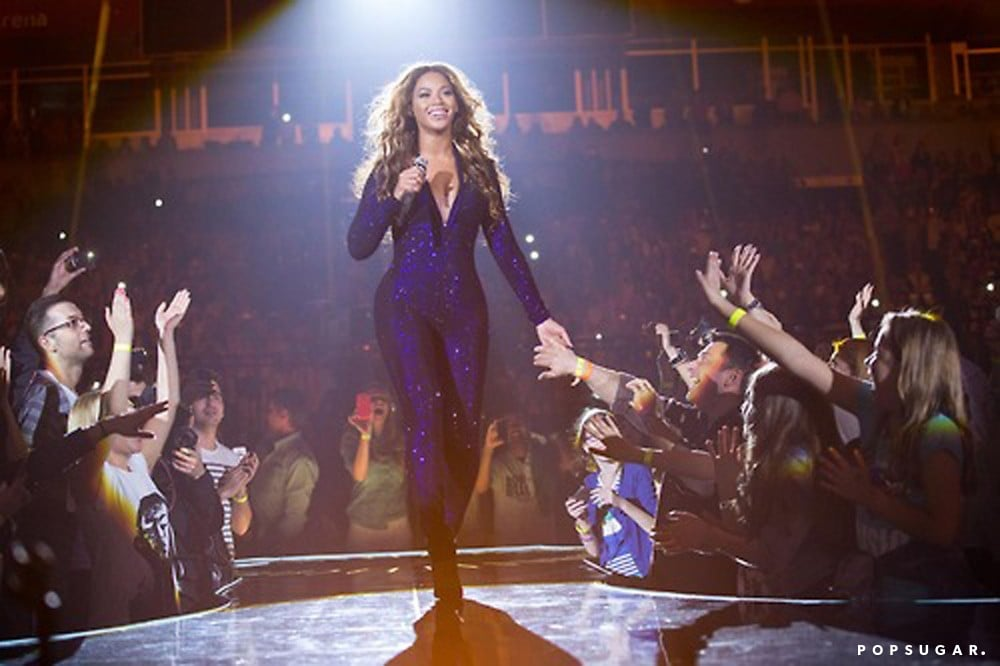 While interacting with her fans, Beyoncé sparkled (literally) in a purple plunging sequined jumpsuit.