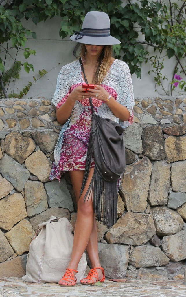 Jessica Alba stopped to check her phone in St. Barts on Friday.